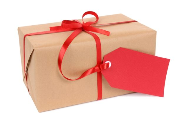 Brown paper package tied with red ribbon and gift tag.